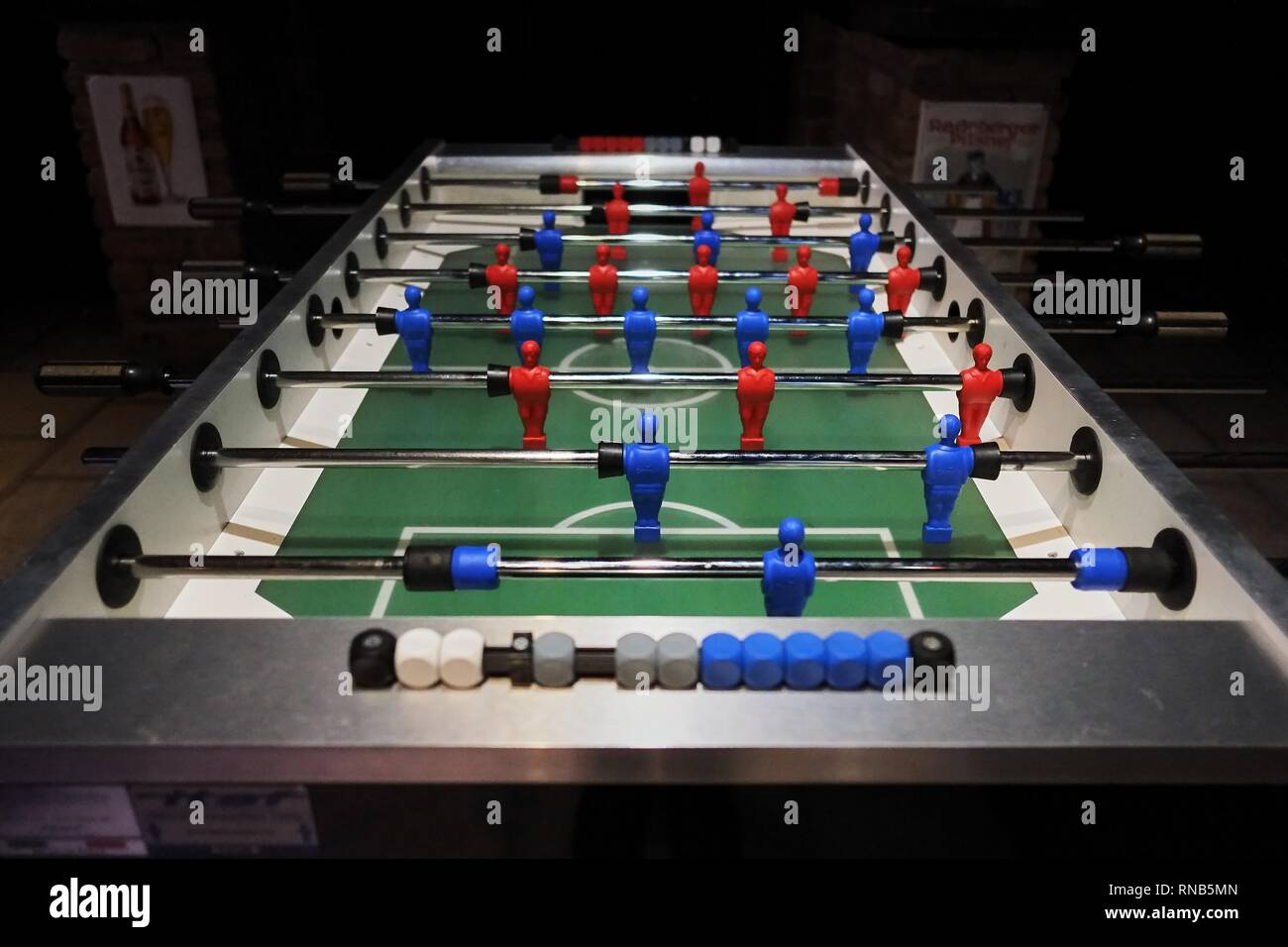 Table soccer in bar without people dark area - Stock Image