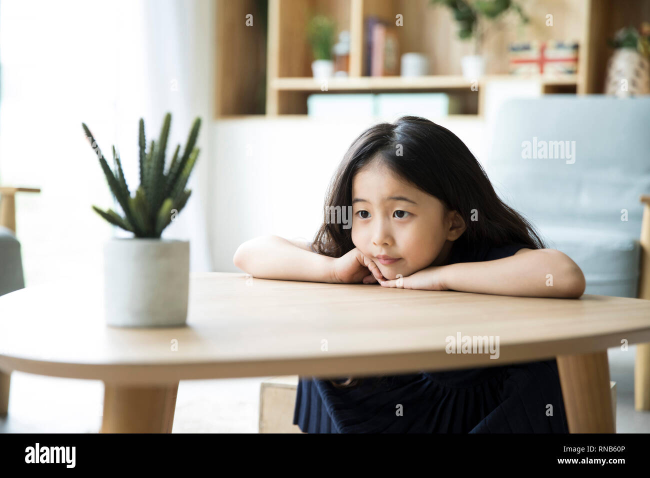 A Little Girl Lying On The Table Stock Photo Alamy