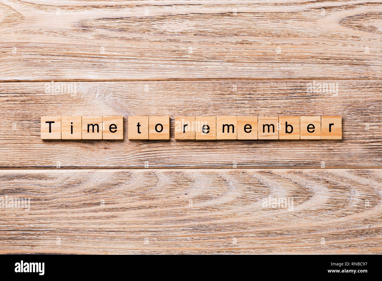 Time To Remember word written on wood block. Time To Remember text on wooden table for your desing, concept. - Stock Image