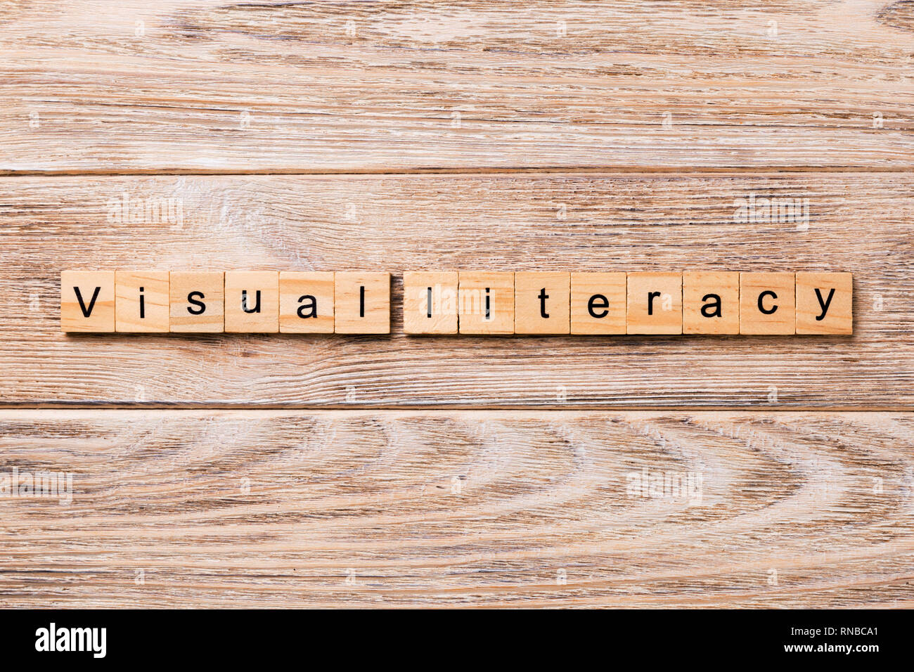 visual literacy word written on wood block. visual literacy text on wooden table for your desing, concept. - Stock Image