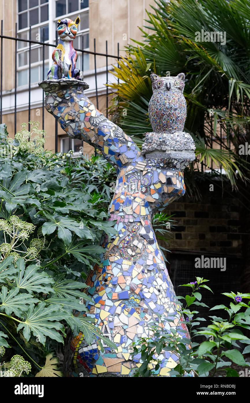 Mosaic in a inner city garden - Stock Image