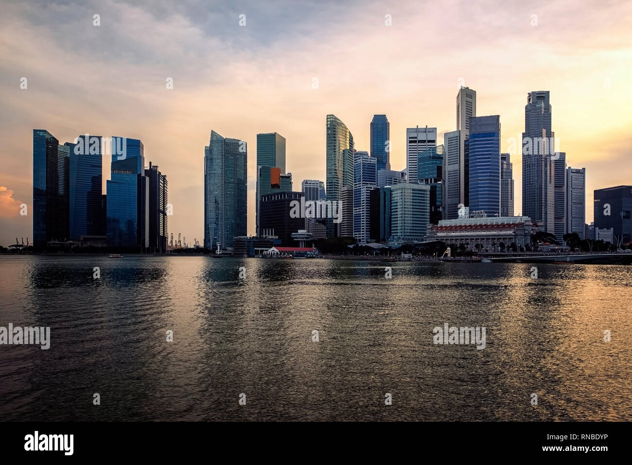 View of Marina Bay at sunset in Singapore City - Stock Image