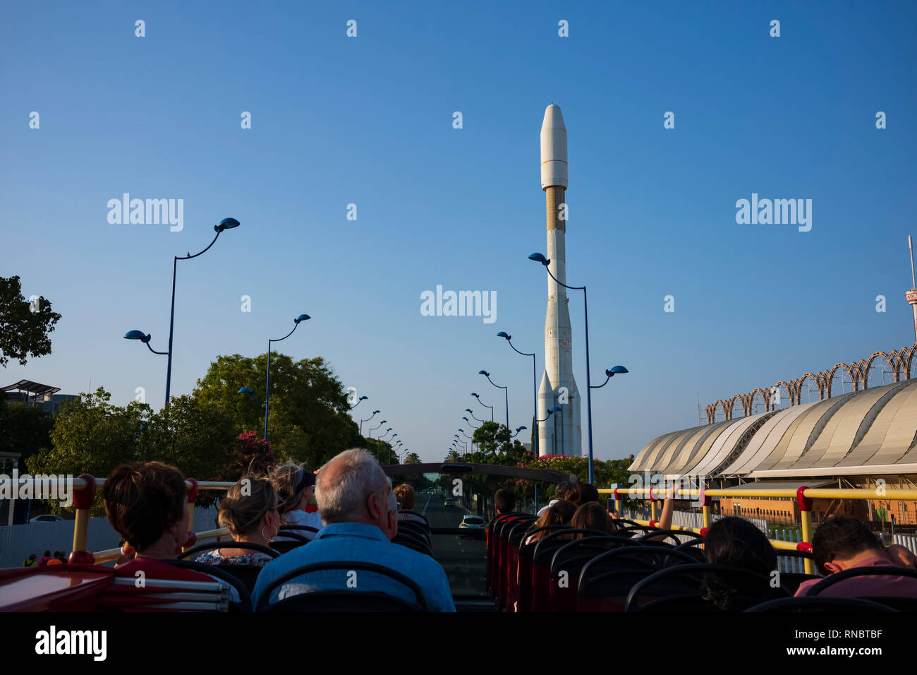 Replica of an Arianne Sky Rocket, at the site of the Universal Exposition of Seville, Expo '92, seen from a open-air tour bus in Seville, Spain. - Stock Image