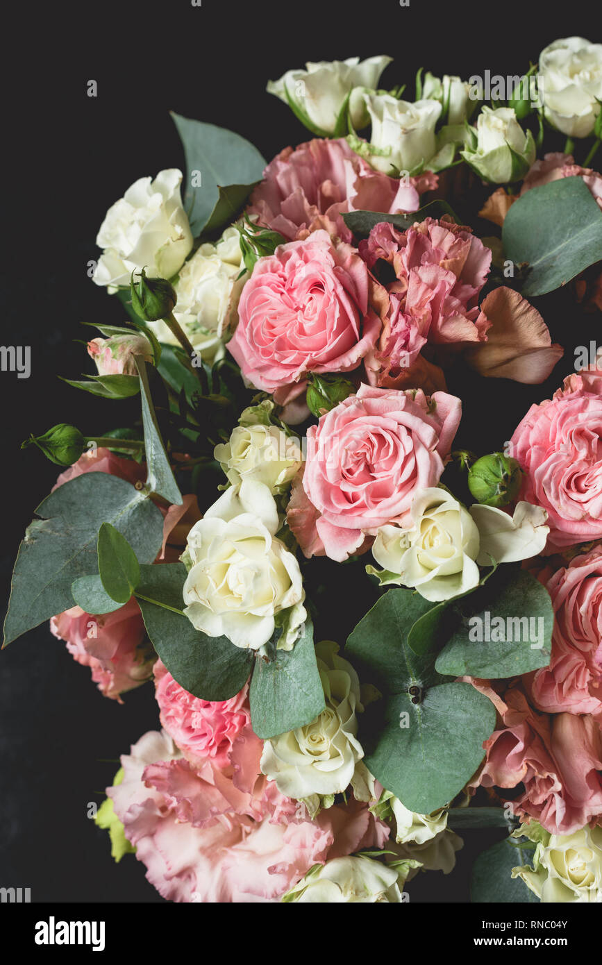 Bouquet Of Roses And Eucalyptus Over Black Background Wedding Birthday Flowers Bouquet Stock Photo Alamy