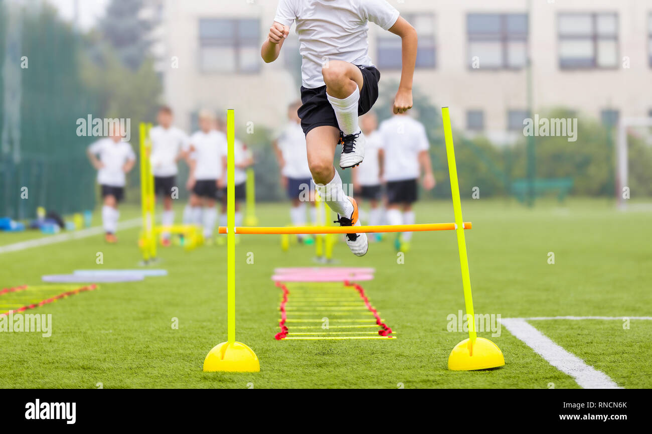 Soccer Player on Fitness Training. Footballers on Practice Session in Field on Sunny Day. Young Soccer Players at Speed and Agility Practice Training  - Stock Image