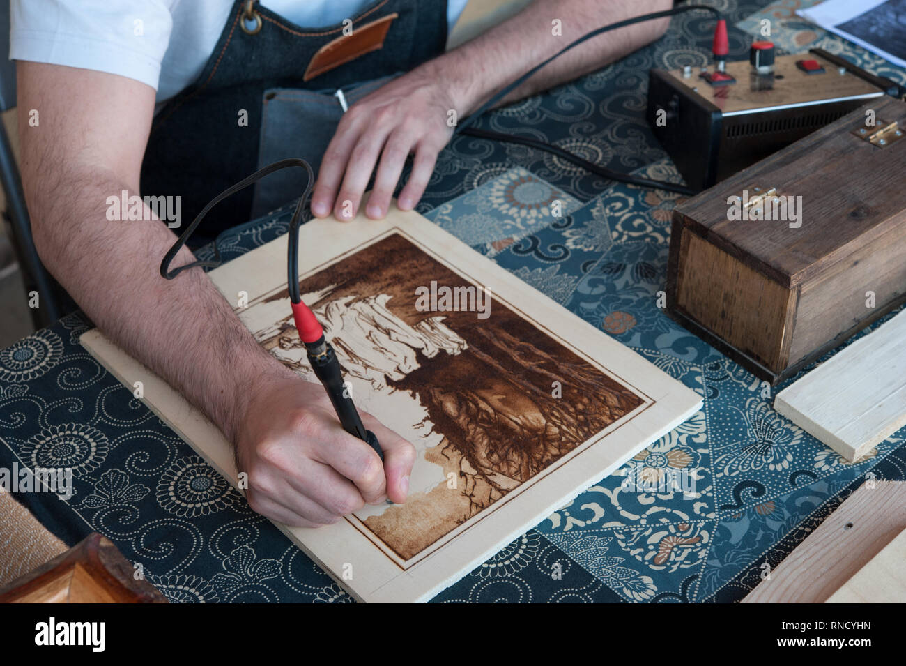 The Pyrography is an engraving technique by means of a heat source, on wood, leather, cork and other materials - Stock Image