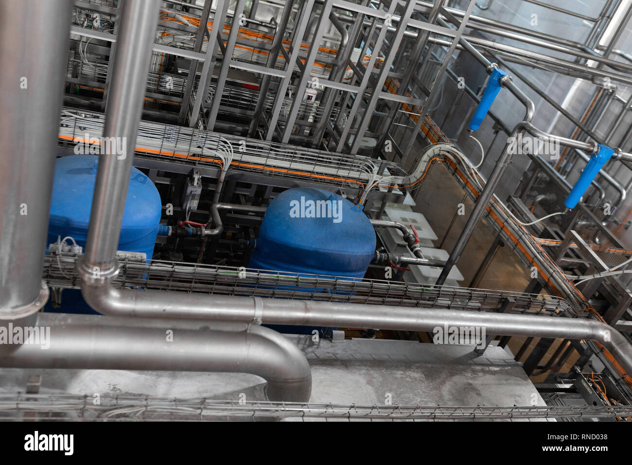 Pipeline and blue tanks. Pressure supply system - Stock Image