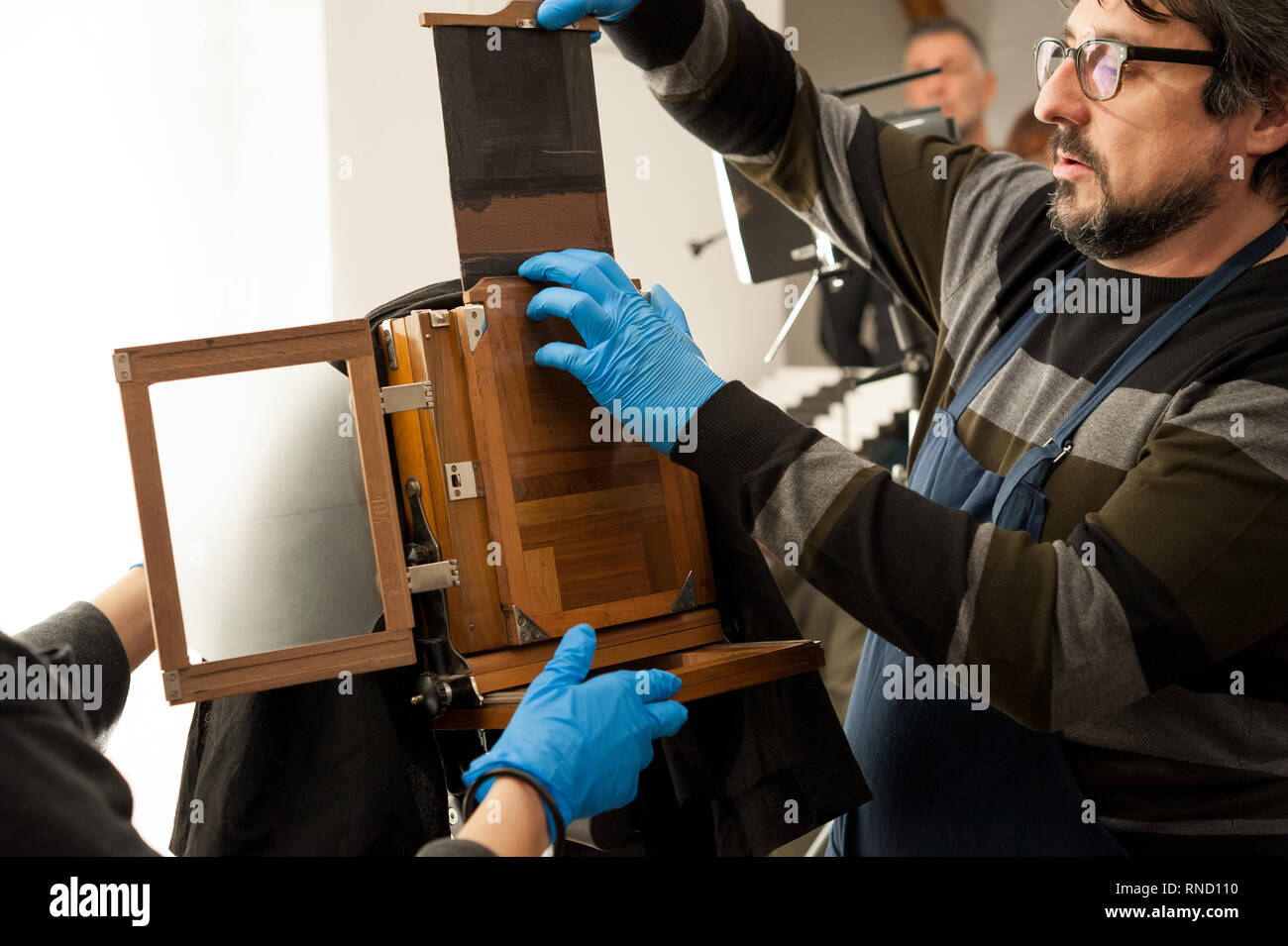 Photographer sets an old large format camera with photographic plate chassis, before the shooting. - Stock Image