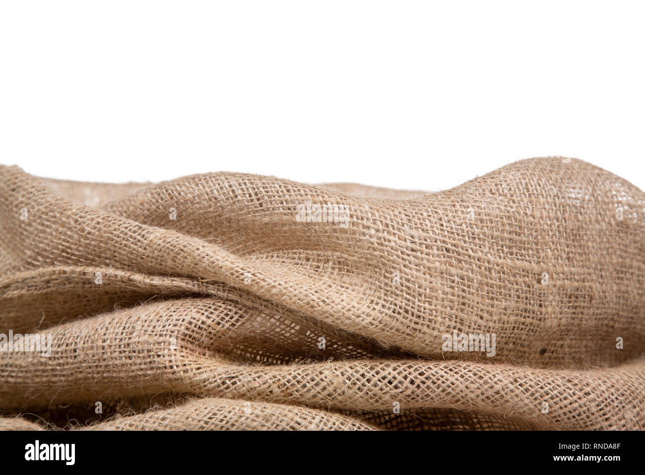 b030d6bb618 Border of burlap or jute open woven fabric on white background. - Stock  Image