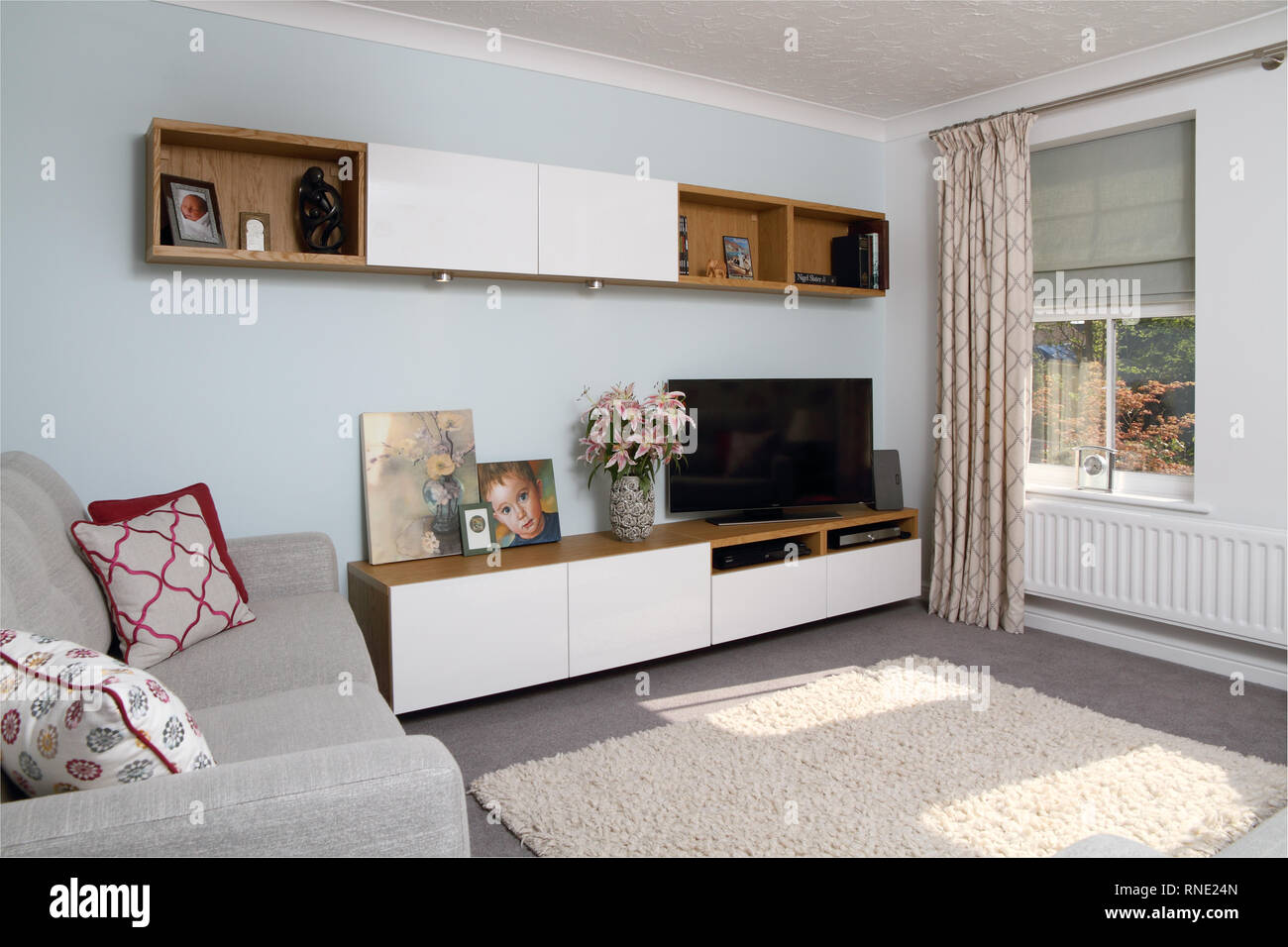 Modern living room with media unit and matching wall mounted ...