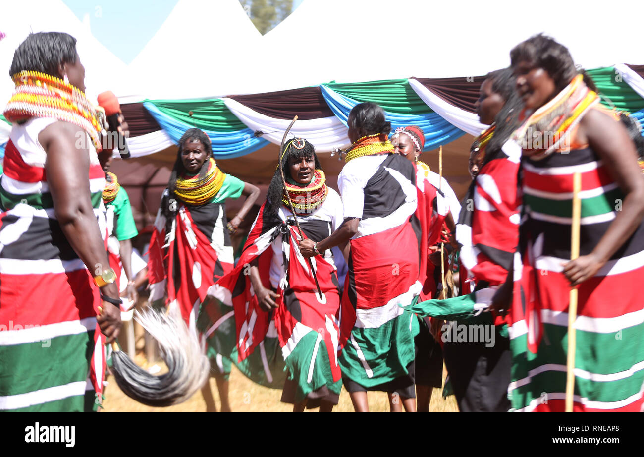 Kenya's traditional dancers seen dressed in Kenyan flags performing during the commemoration. Kenya's freedom fighters against British colonial rule called 'Mau Mau' commemorated the execution of their leader Dedan Kimathi on February 18, 1957. His body was buried at an unknown grave, widow Mukami Kimathi wants his grave disclosed and remains exhumed for a decent burial. - Stock Image