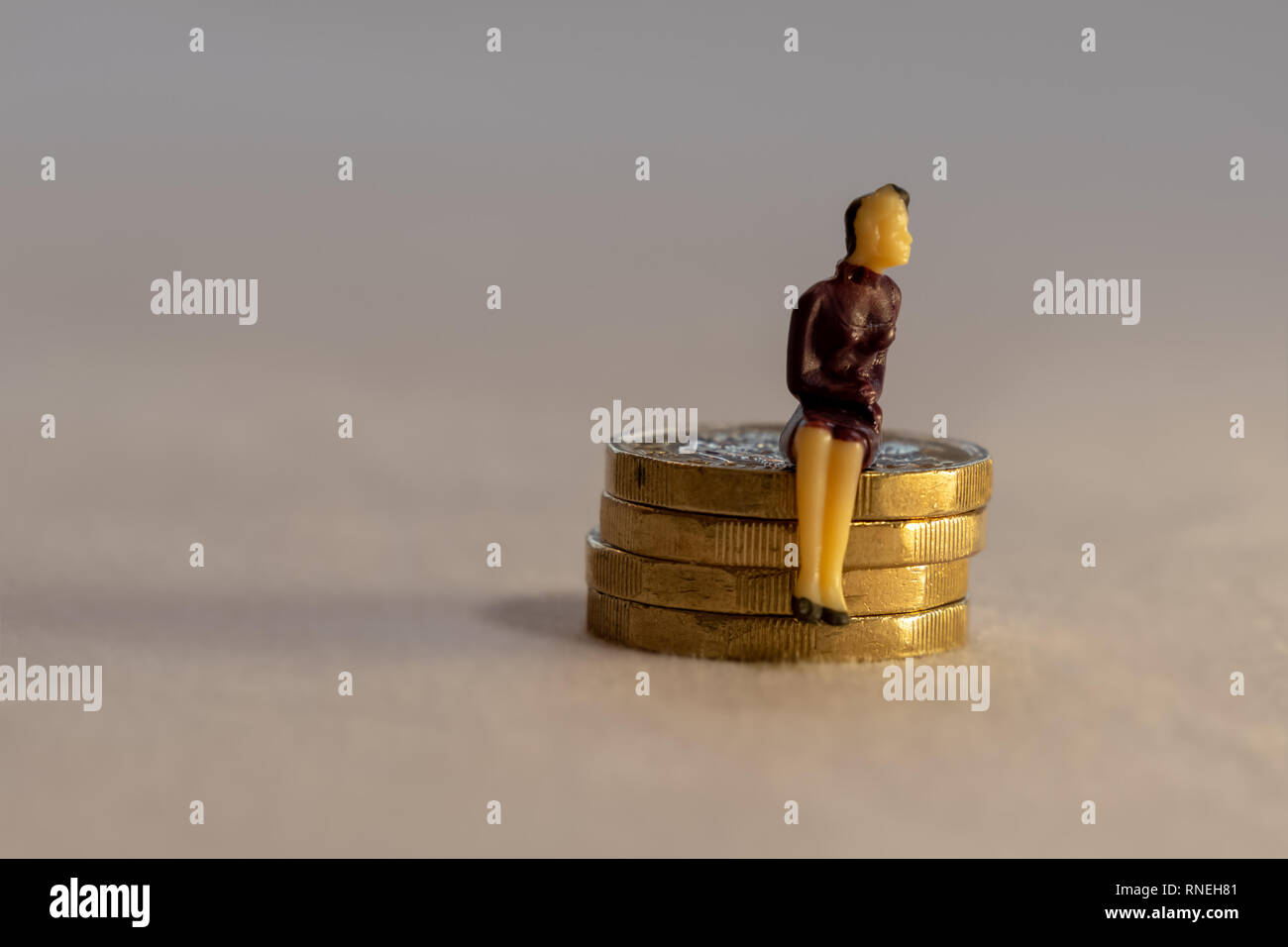 Business woman and pile of coins. Saving money retirement or investment concept. - Stock Image