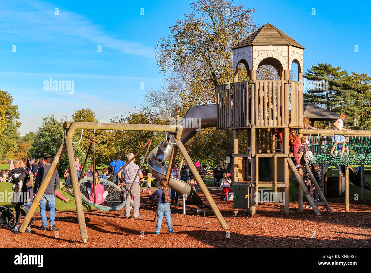 LONDON - OCT 25, 2017: Colorful playground on yard in the park where children have fun with there parents - Stock Image