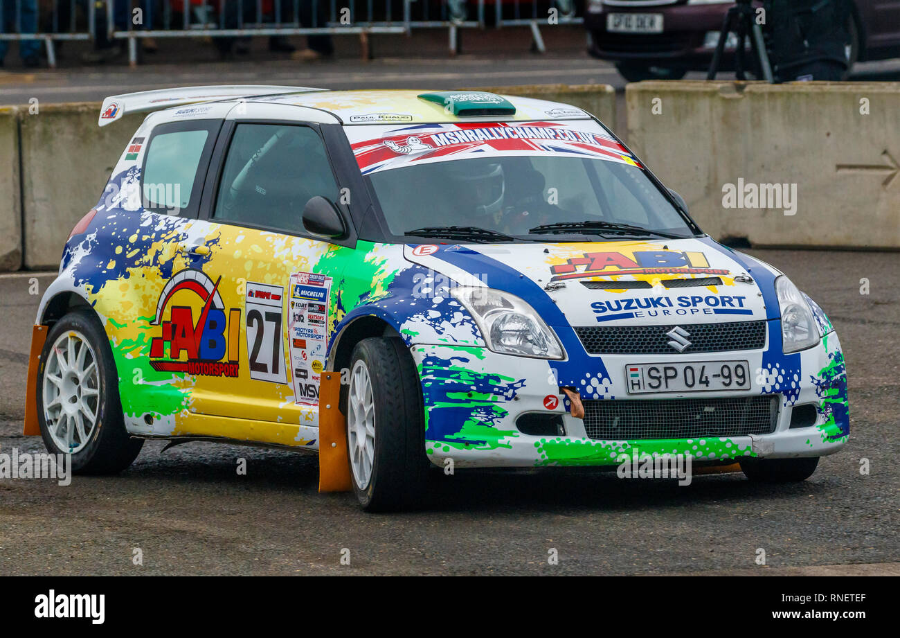 Suzuki Swift S1600 JWRC, SP-04-99, with driver Abi Mahmood and co-driver Samantha Bartlett during the 2019 Snetterton Stage Rally, Norfolk. - Stock Image