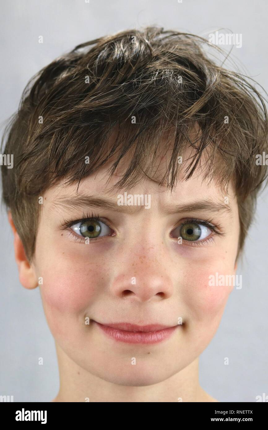 Portrait of a child with a confused look on the face - Stock Image