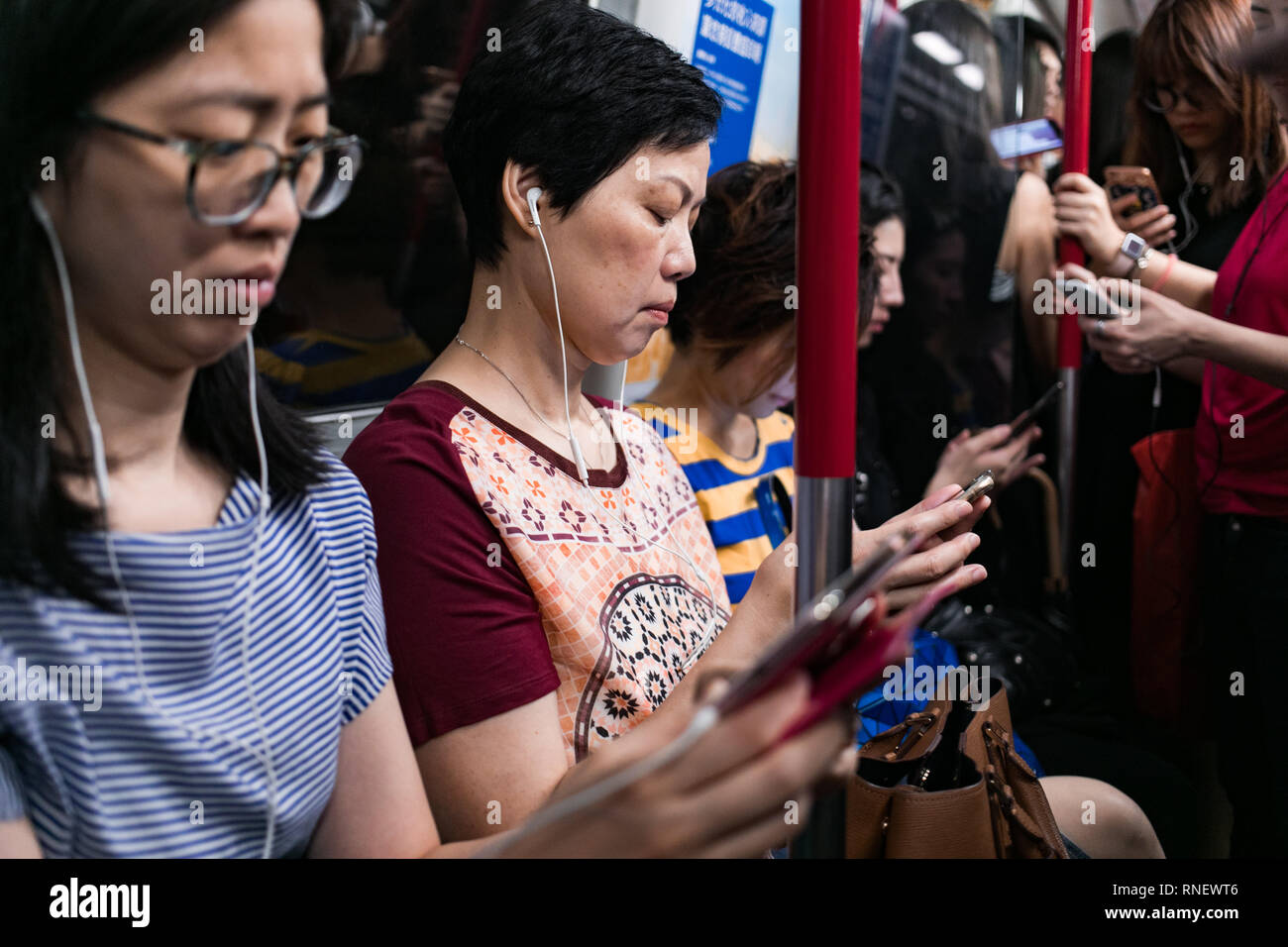 passengers on the hong kong metro - Stock Image