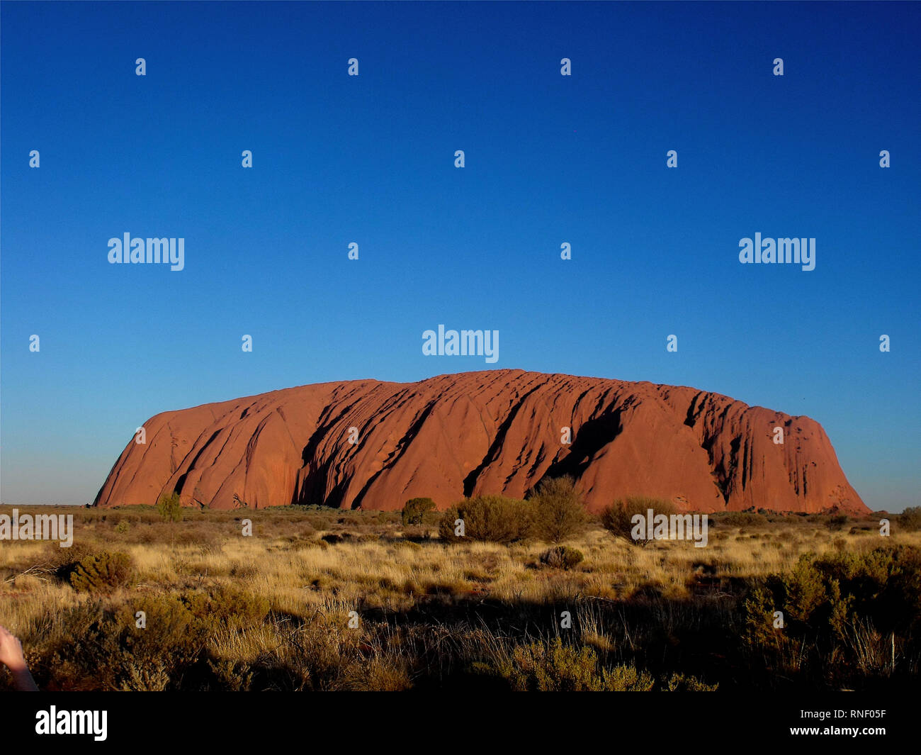 Majestic Uluru at sunset on a clear winter's evening - Stock Image