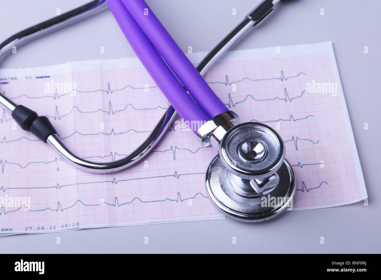RX prescription, Red heart and a stethoscope isolated on white background - Stock Image