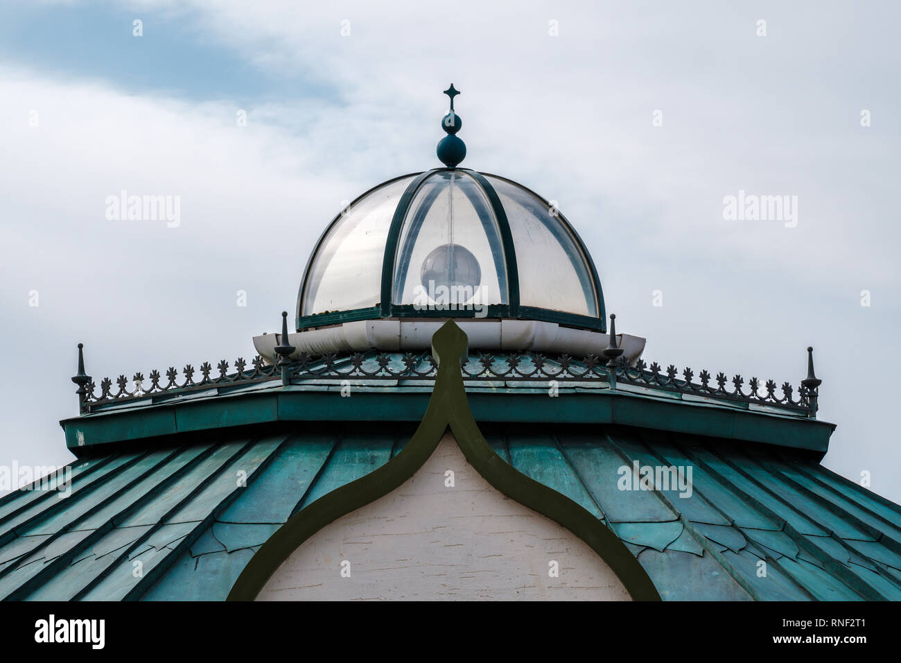Victorian style green roof and glass dome of a building in Rhyl's Children's Village on a cloudy day, Rhyl, Denbighshire, North Wales - Stock Image