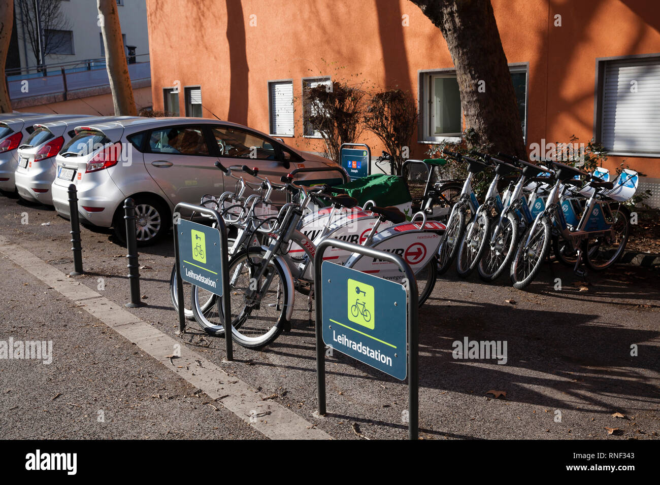 Mobilstation on Josephstreet in the Severins district, Cologne, Germany. The station offers carsharing, bikesharing, cargo bike sharing and bike parki - Stock Image