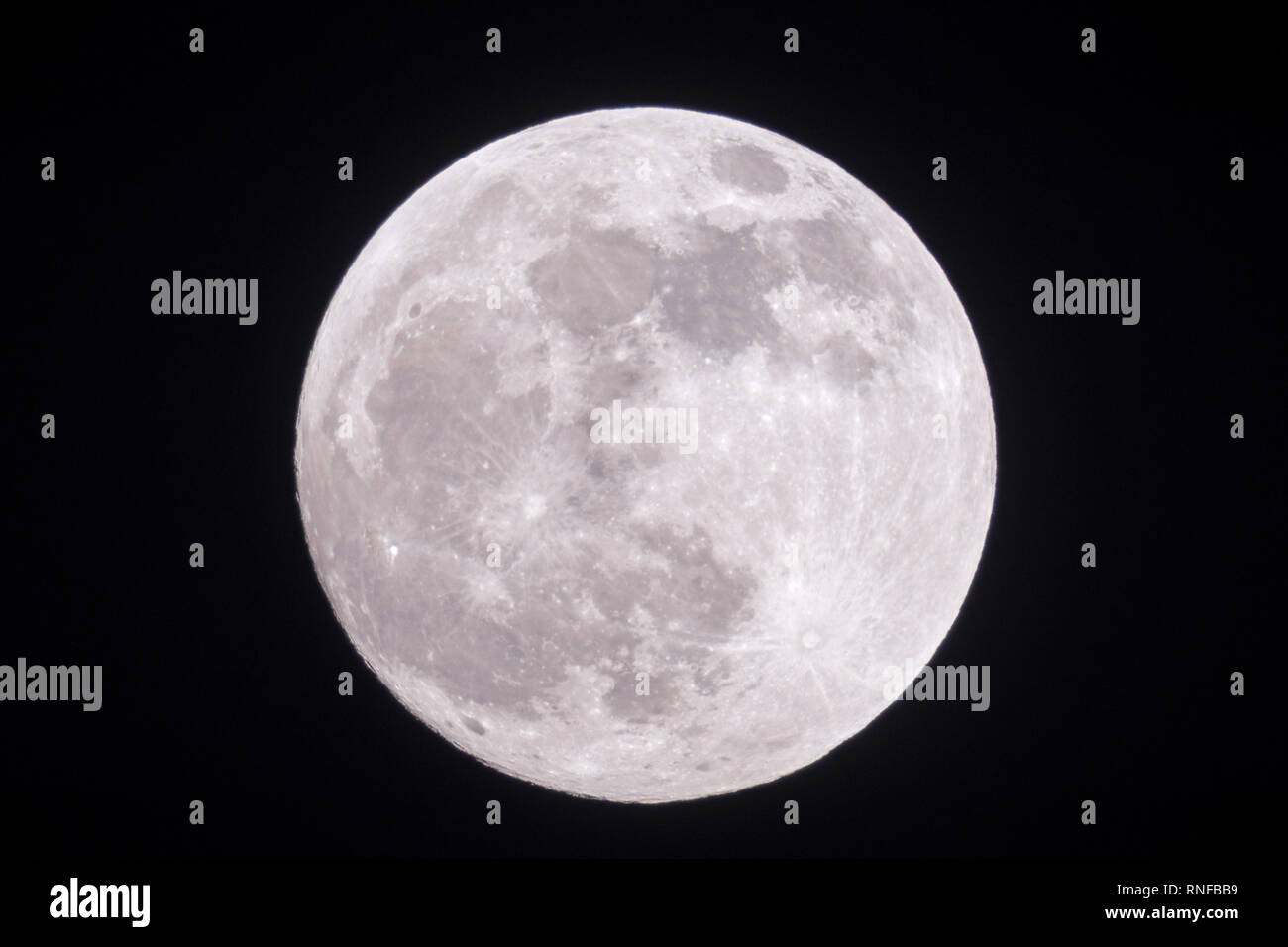 Full moon, fullmoon is shining bright , silver light, close, clear dark winter night, looks close, supermoon, detailed view, January, 2019. - Stock Image
