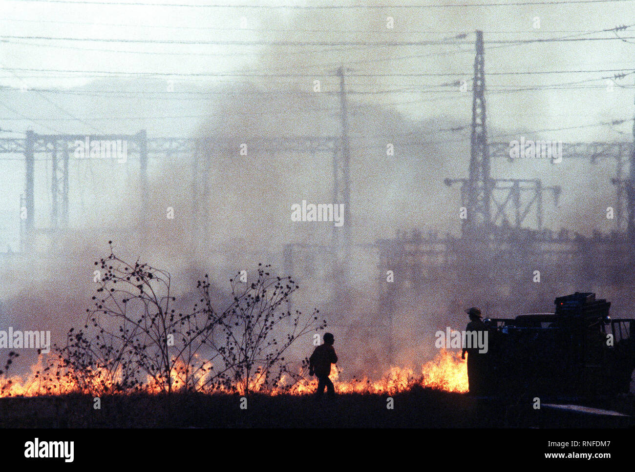 An early-staged fire rages near Norton Air Force Base during the four-day Panorama brush fire, which started in canyons north of town and has been whipped out of control by 40-50 mph winds. Stock Photo