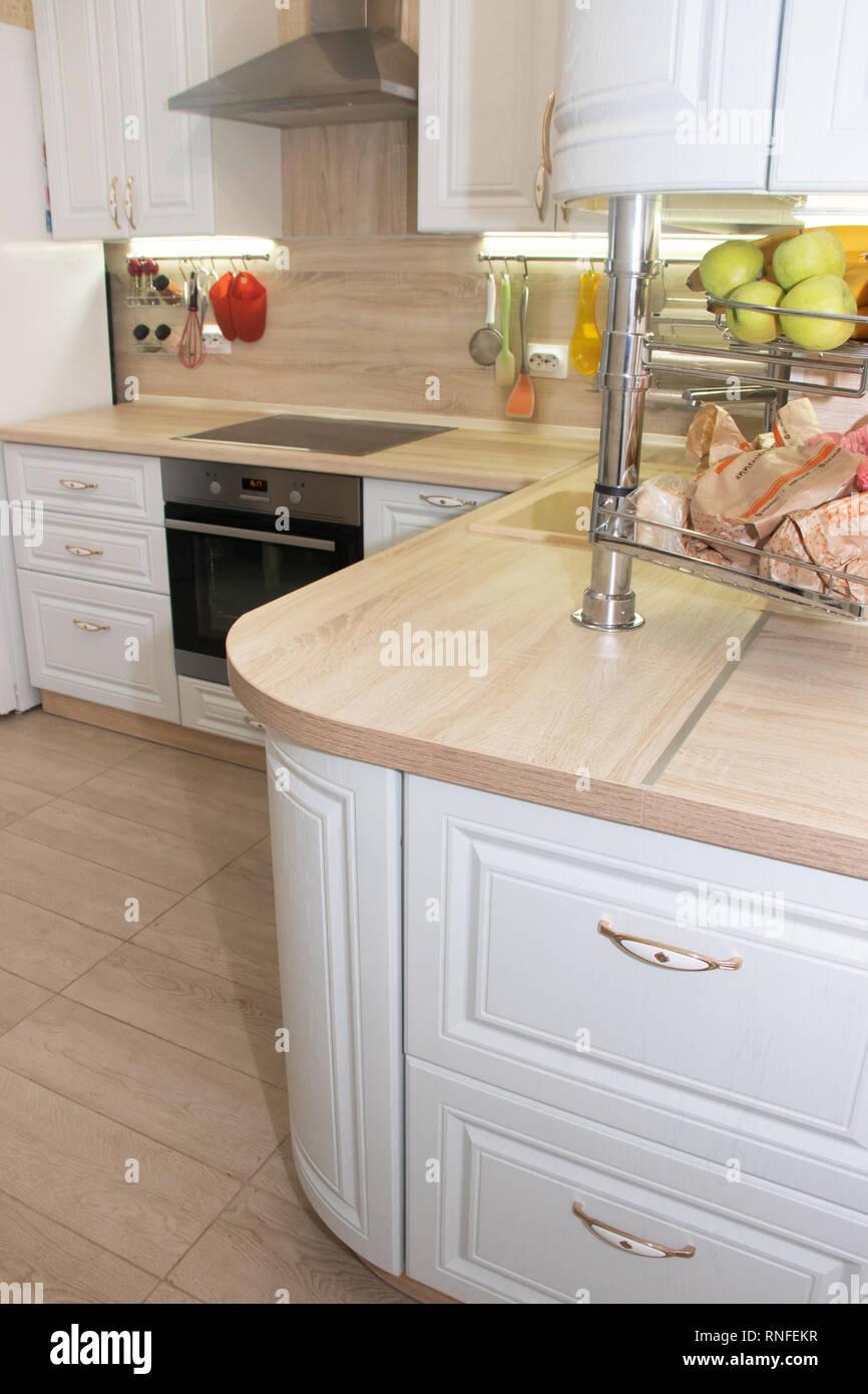 White modern kitchen from solid oak. Modern kitchen. White kitchen. Russia, St. Petersburg, Murino February 10 2019 Stock Photo