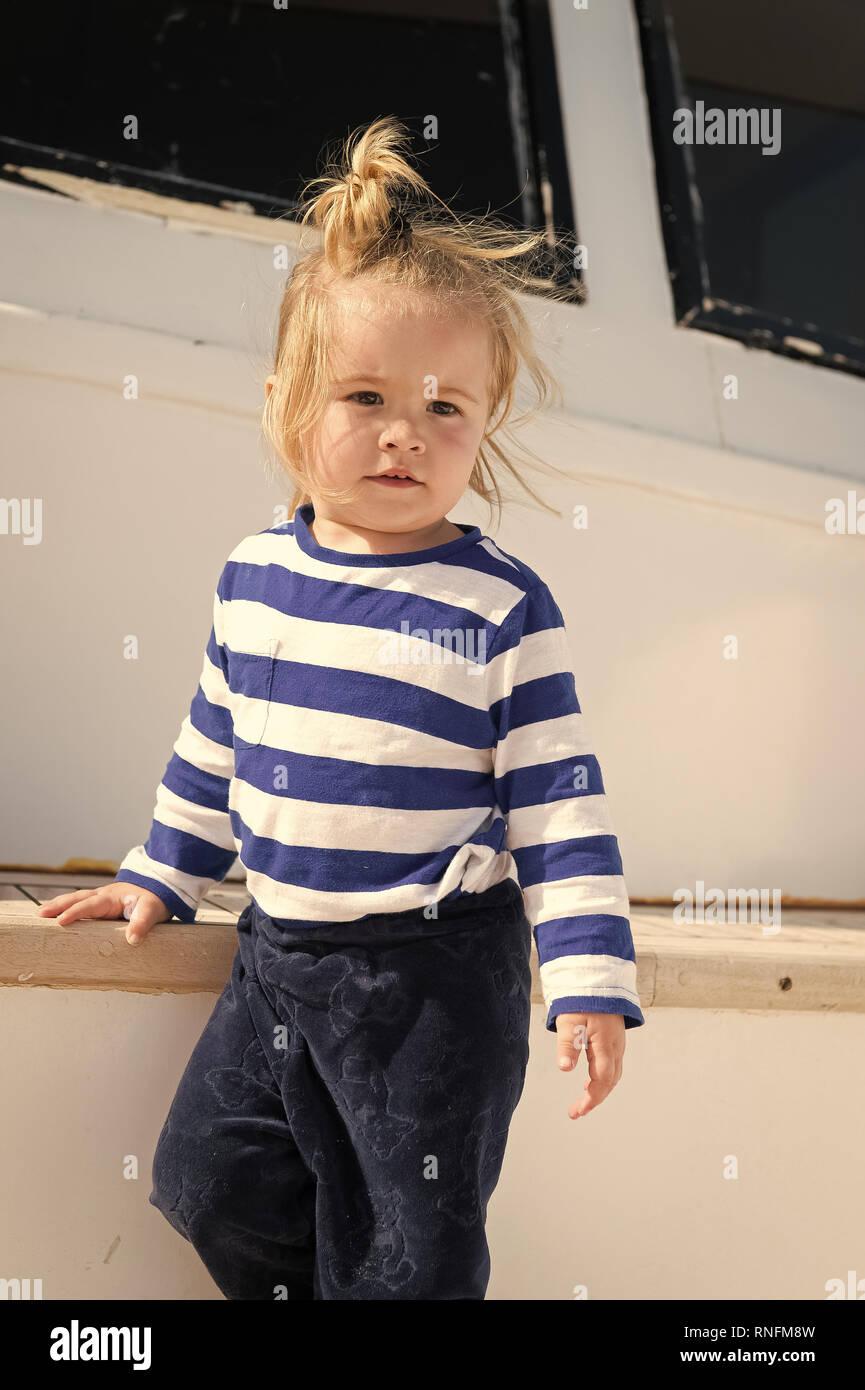 7d49af59d Kids fashion on vacation. Boy adorable sailor striped shirt yacht ...