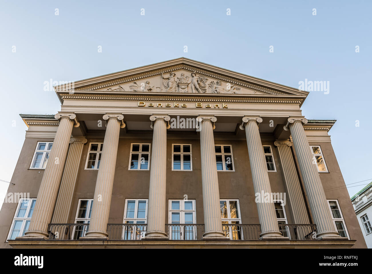 The facade of the money-laundering Danish Bank with ionic columns and a sclprured pediment, Copenhagen, February 16, 2019 - Stock Image