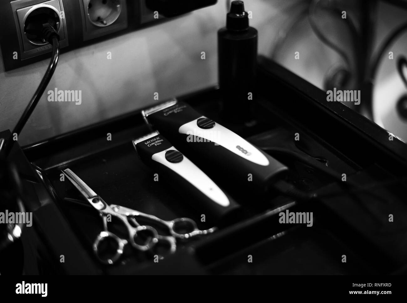 clipper and shaving machine, scissors, hairdryer, spray. beauty saloon tools for haircuts Stock Photo