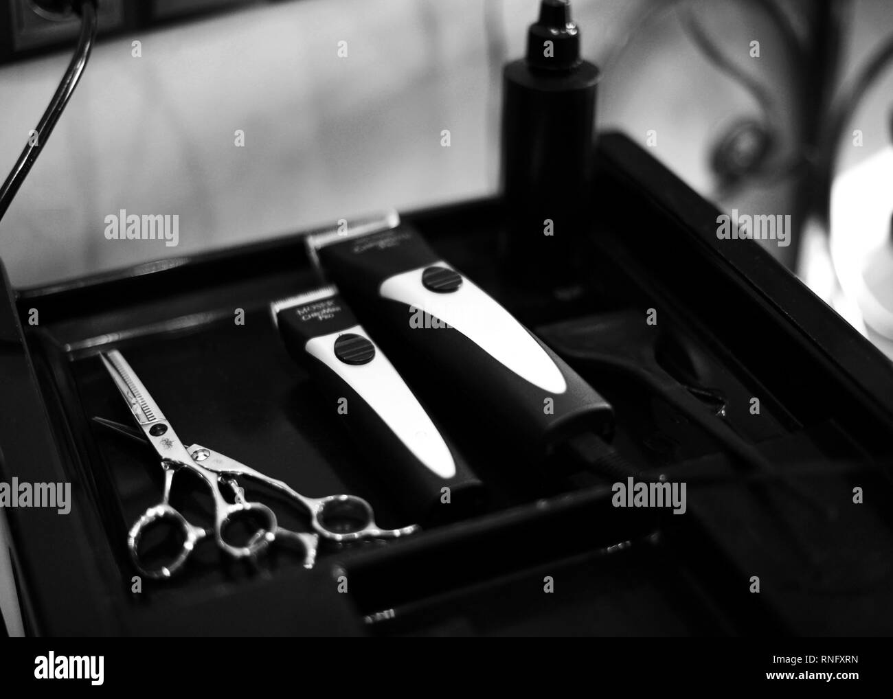 clipper and shaving machine, scissors, hairdryer, spray. beauty saloon tools for haircuts - Stock Image