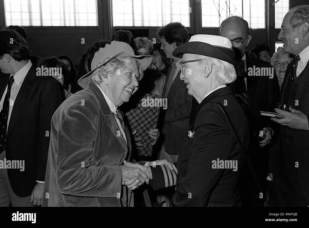 1983 - Captain Grace Murray Hopper is congratulated by a guest at the conclusion of the ceremony to dedicate a computer learning center in her name at Brewster Academy. - Stock Image