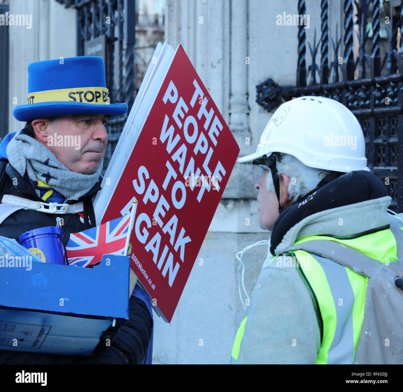 An anti and pro Brexit campaigner, arguing outside the House of Parliament, on Parliament Square, London, UK, about the pros and cons of Brexit. - Stock Image