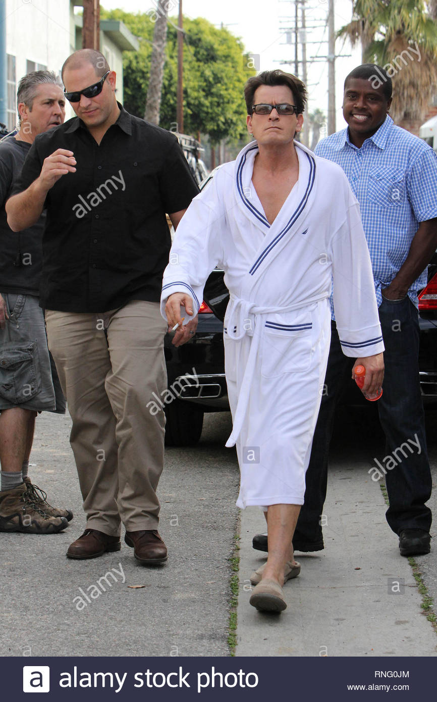 West Hollywood, CA -  Charlie Sheen has some fun with the paparazzi while standing in a bath robe in an alley during a break for a commercial he's filming.  The Hollywood bad boy told jokes, and had fun with everyone all while standing in a white robe and house slippers. GSI Media          January 27, 2012  To License These Photos, Please Contact :  Steve Ginsburg (310) 505-8447 (323) 4239397 steve@ginsburgspalyinc.com sales@ginsburgspalyinc.com  or  Keith Stockwell (310) 261-8649 (323) 325-8055  keith@ginsburgspalyinc.com ginsburgspalyinc@gmail.com - Stock Image