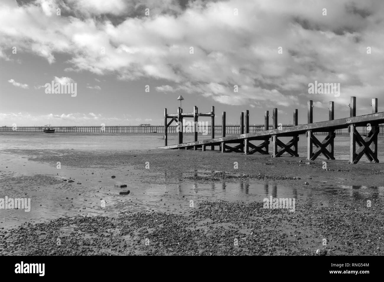 Black and white image of the Jetty on Jubilee beach, Southend-on-Sea, Essex, England Stock Photo
