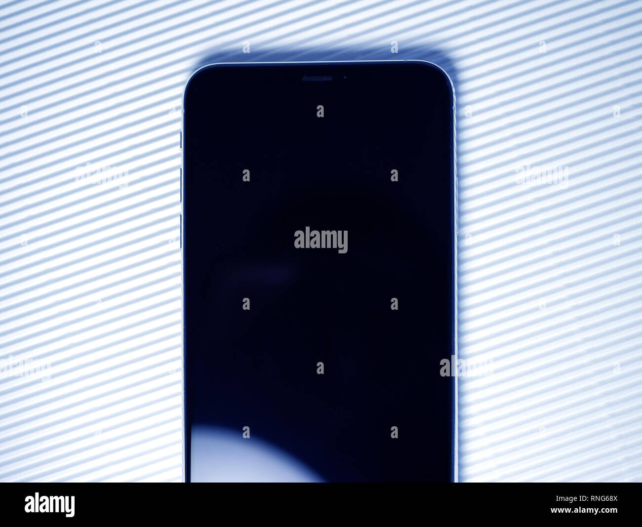 PARIS, FRANCE - SEP 27, 2018: Part detail of new iPhone Xs Max smartphone model by Apple Computers close up with black display screen  - Stock Image