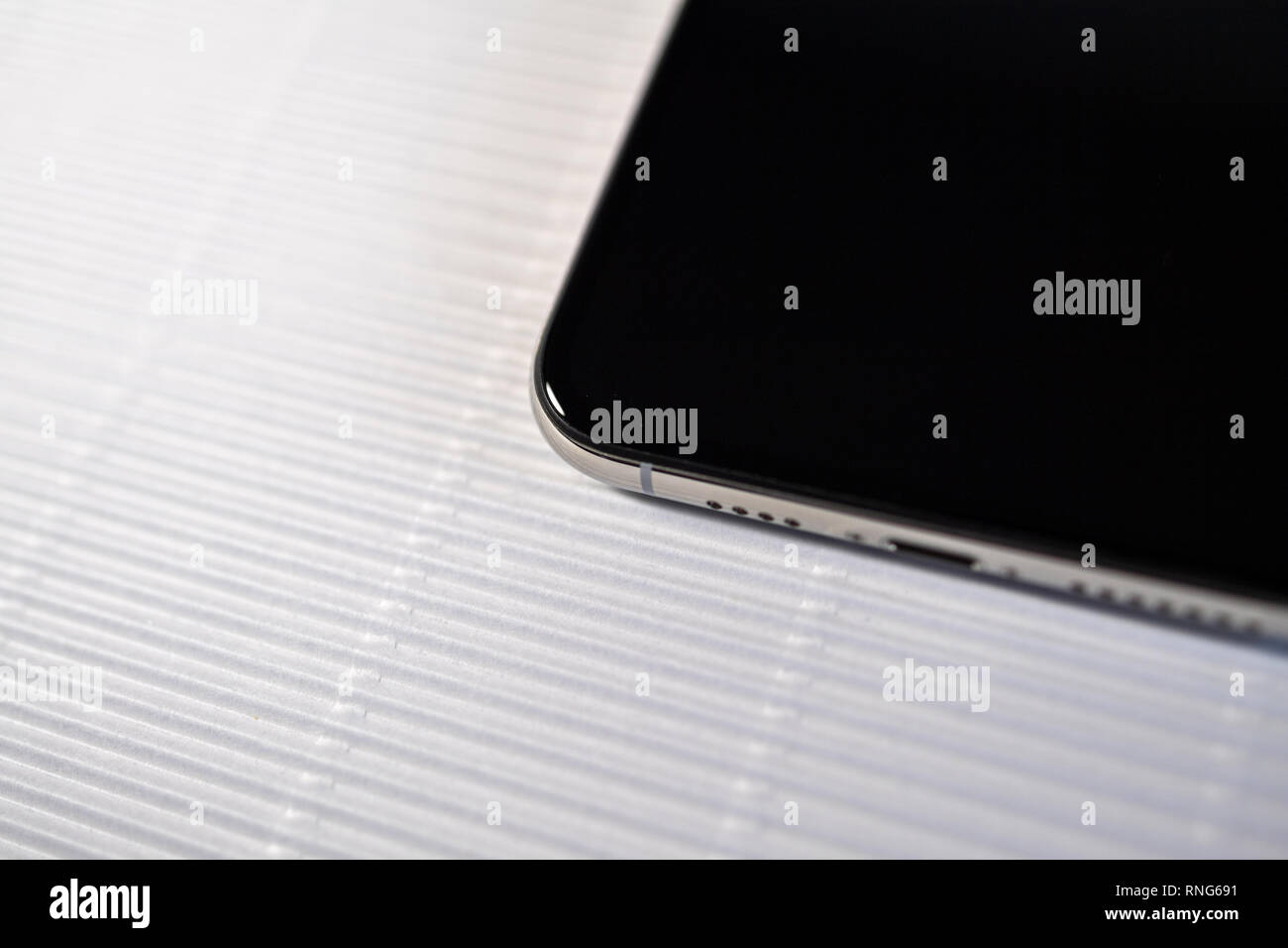 PARIS, FRANCE - SEP 27, 2018: new iPhone Xs Max smartphone model by Apple Computers close up with black display screen  Stock Photo