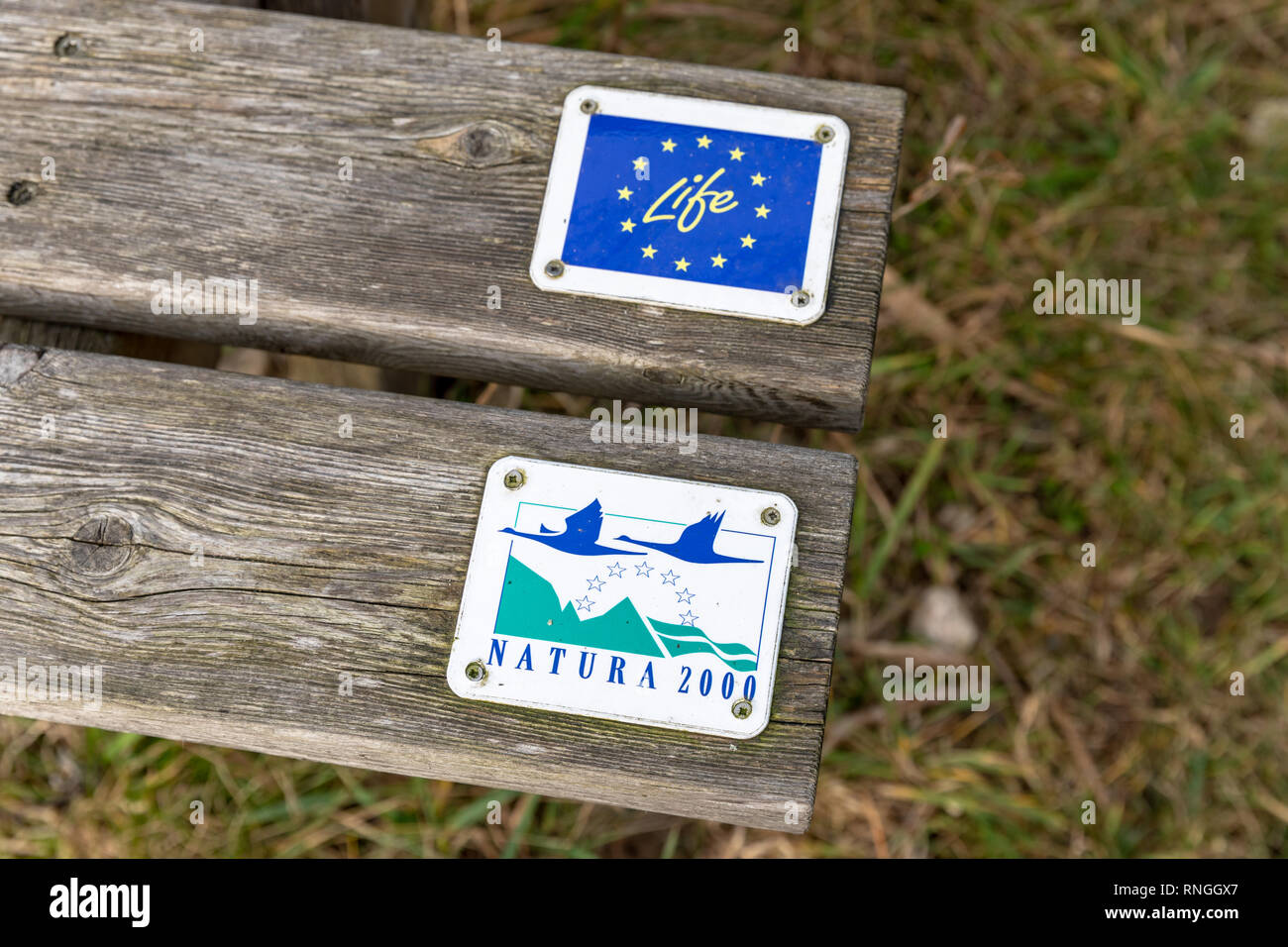 EU LIFE programme and Natura 2000, signs on boards of a wooden bench - Stock Image