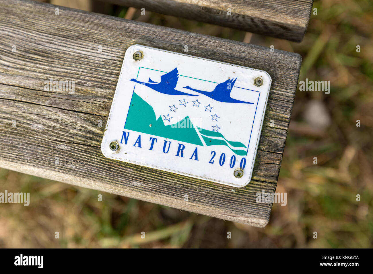 Natura 2000 sign on a wooden bench - Stock Image