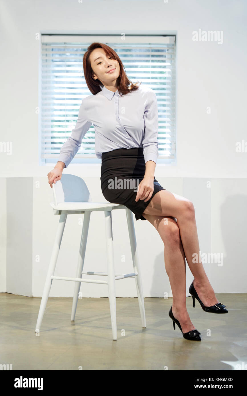 A businesswoman is posing - Stock Image
