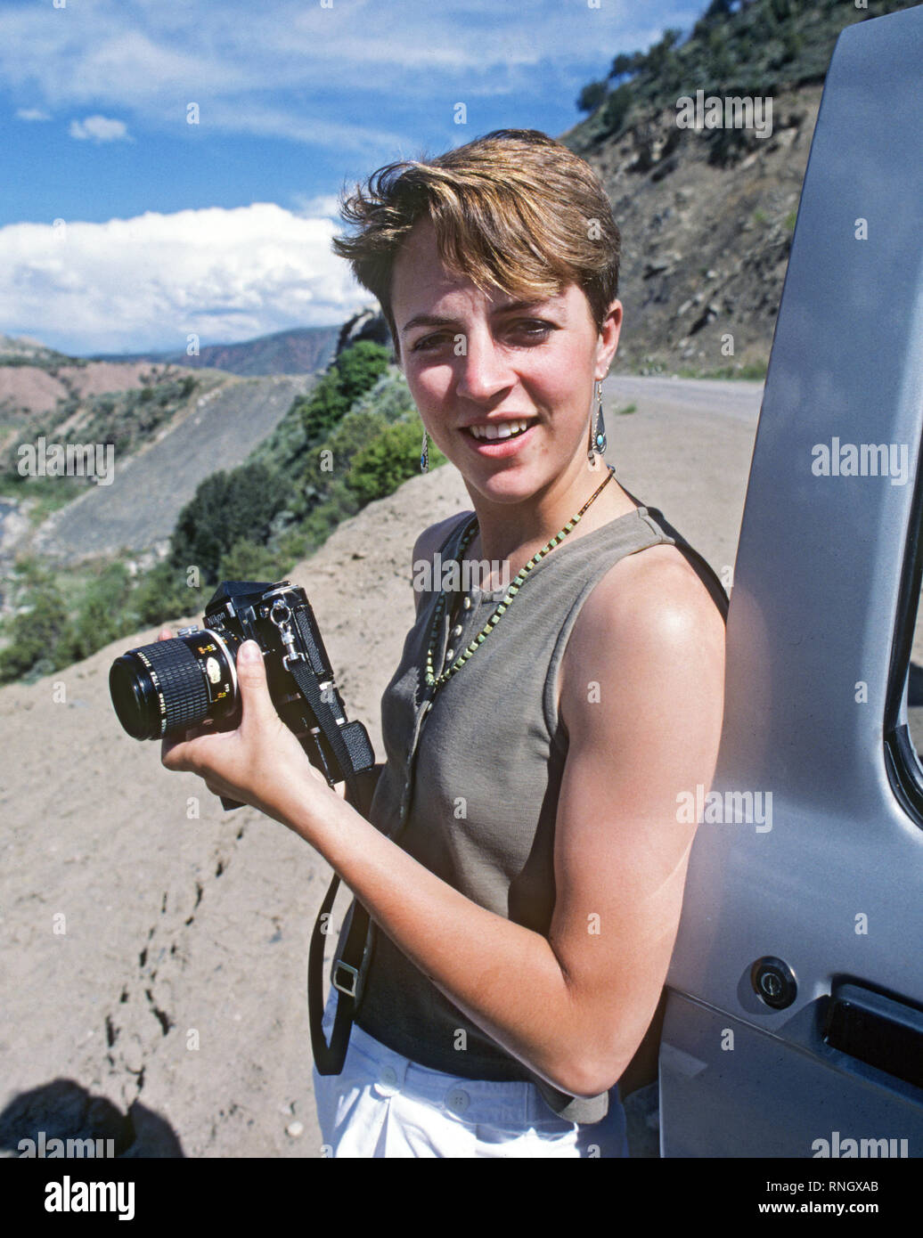 Noted North Carolina photographer Laura Mueller on a mountain road in Colorado - Stock Image
