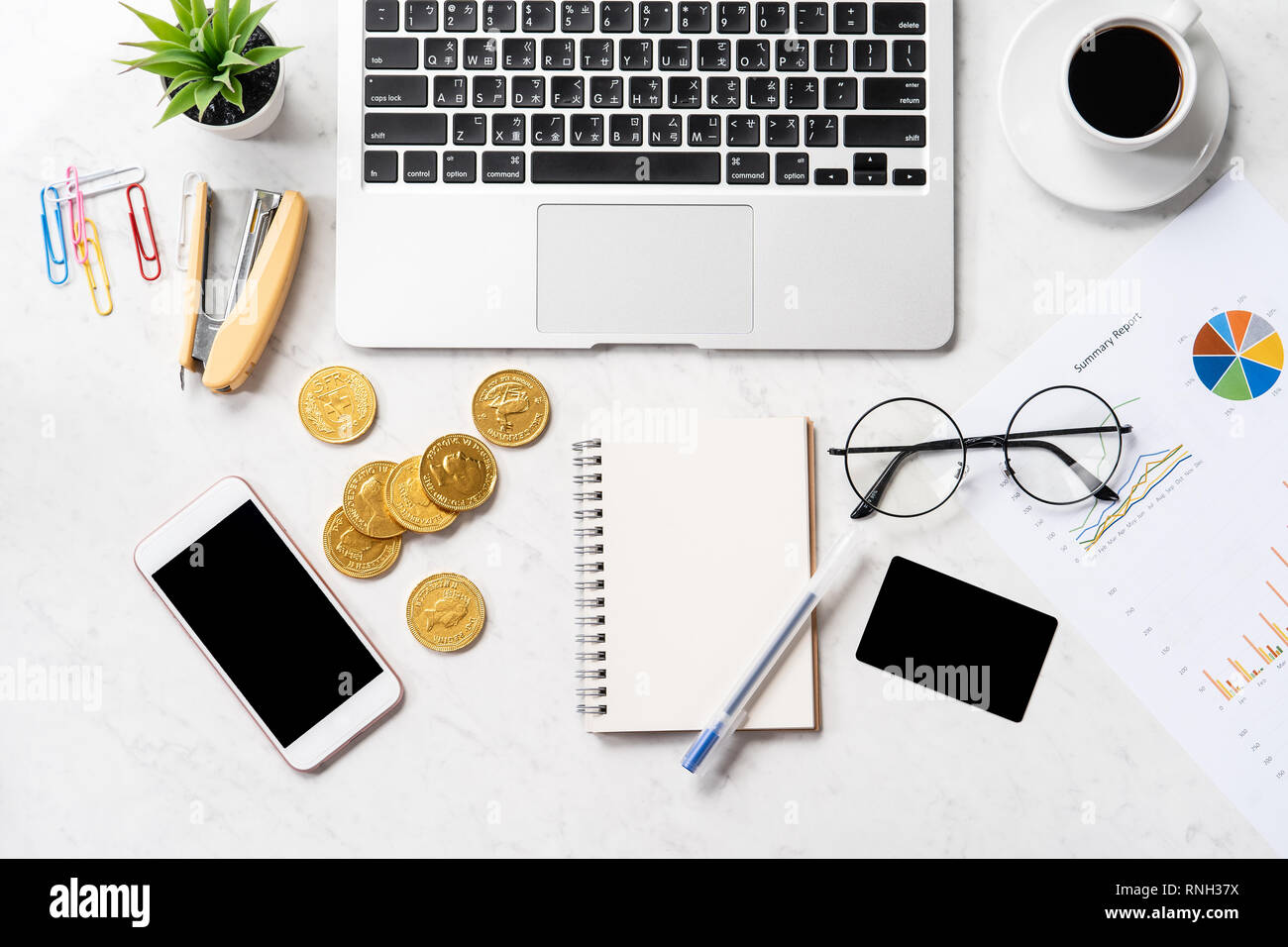 Business, accounting and payment concept with financial report data on a modern marble office table, mock up, top view, copy space, flat lay, lifestyl - Stock Image
