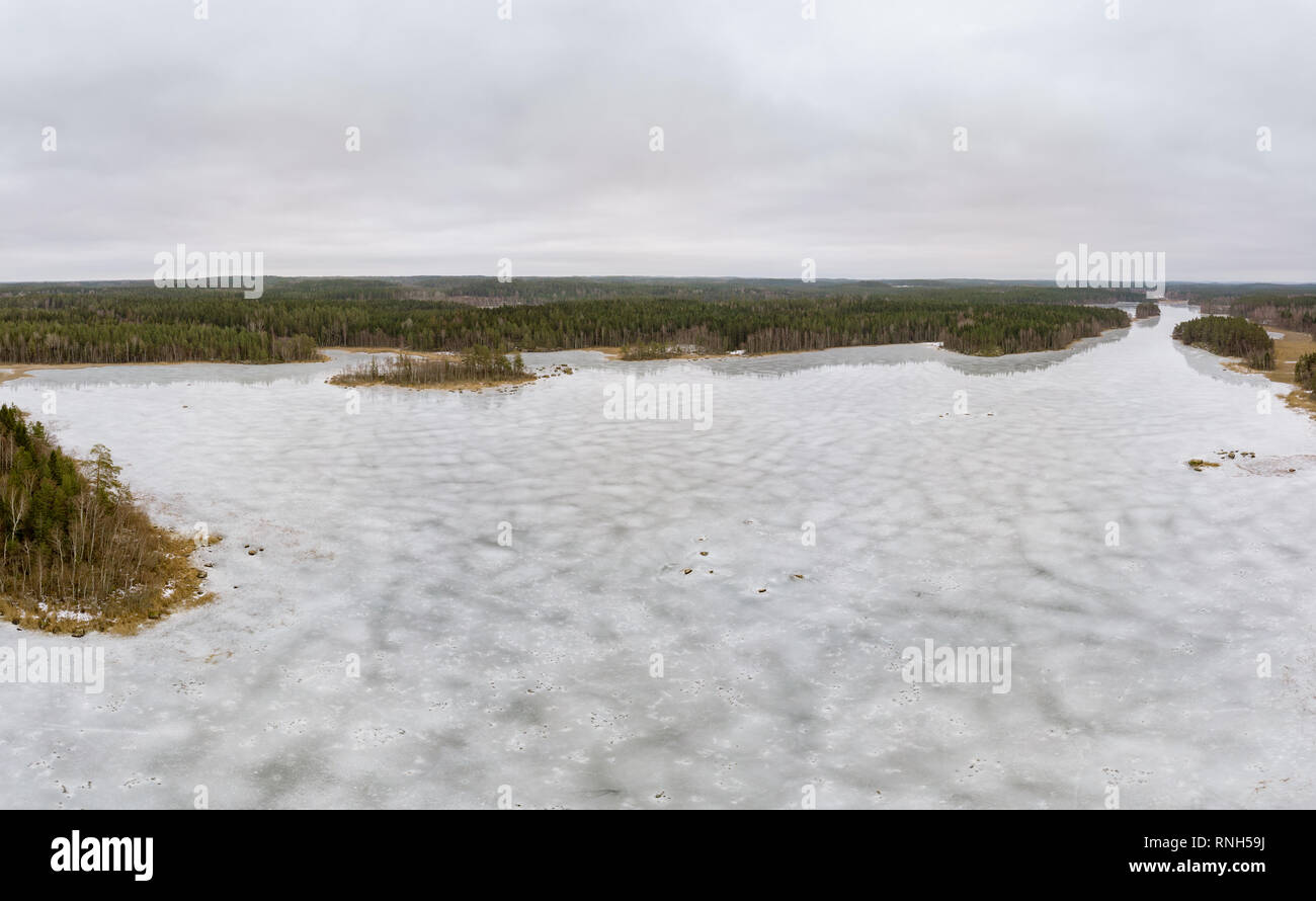 Frozen lake in the forest - Stock Image