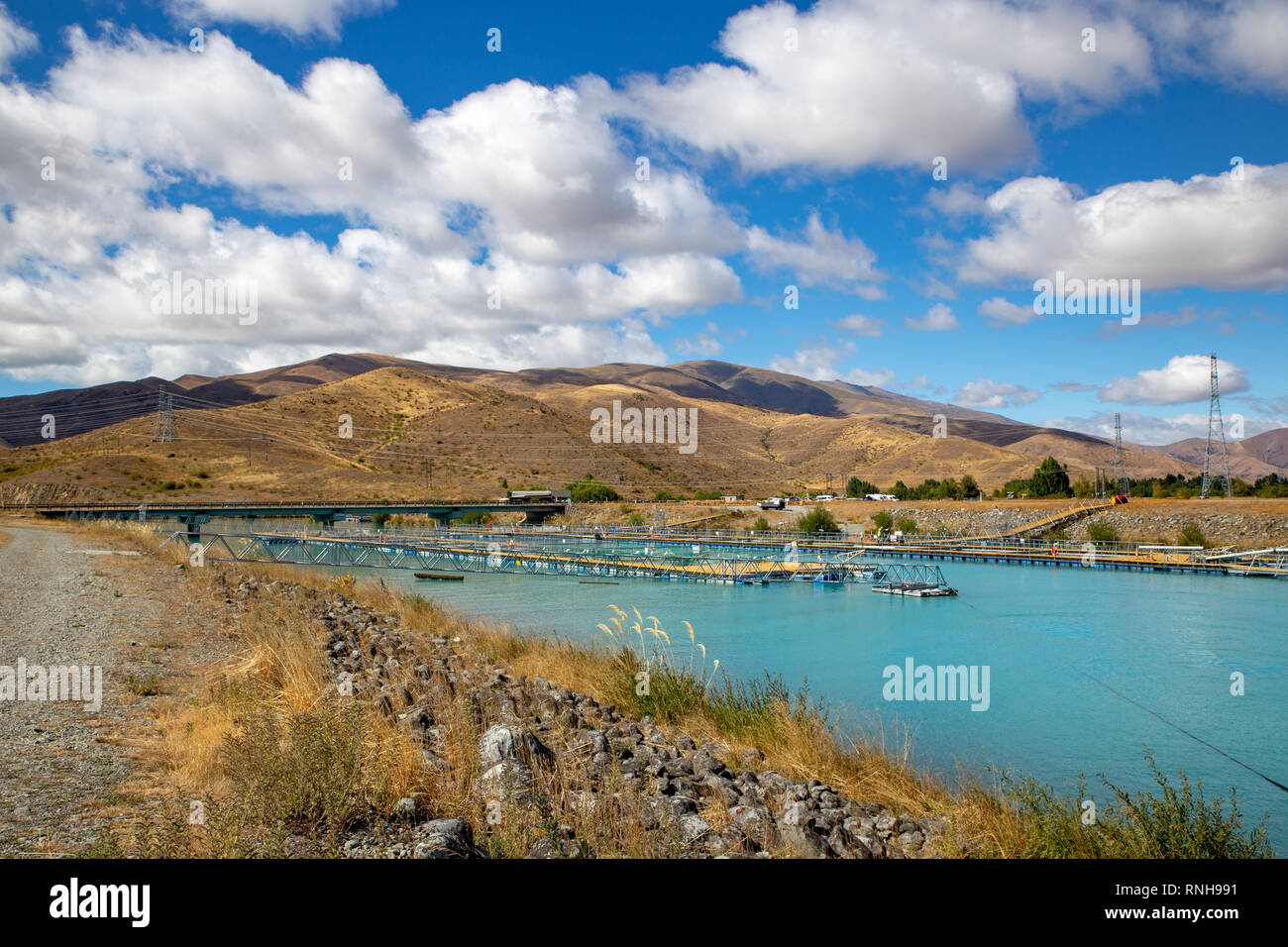 A salmon farm in one of the canals on the outskirts of Twizel, Waitaki Valley, New Zealand - Stock Image
