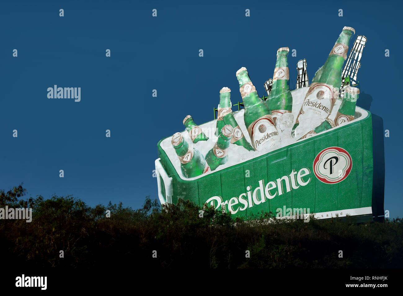 Punta Cana, Dominican Republic - February 7, 2019: Billboard for Presidente the popular beer brewed in the Dominican Republic and exported to several  - Stock Image