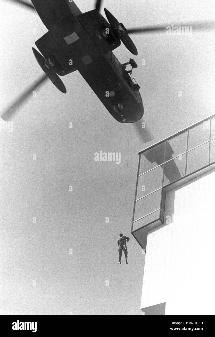 TSGT Jerry Fletcher is lowered from a hovering CH-3E Jolly Green Giant helicopter to a balcony of the blazing MGM Grand Hotel.  The airman is a 302nd Special Operations Squadron member involved in the rescue mission. - Stock Image