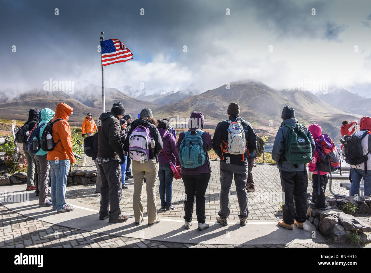 Ranger-guided hike gathers at the flagpole at Eielson Visitor Center, Denali National Park, Alaska, USA - Stock Image