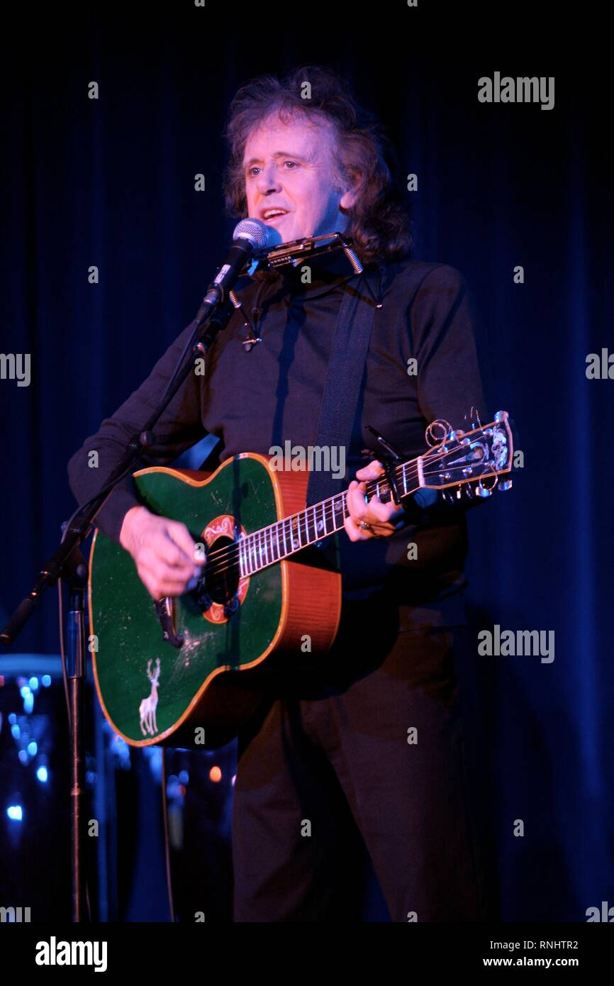 Scottish singer, songwriter and guitarist Donovan, born Donovan Philips Leitch, is shown performing on stage during a 'live' concert appearance. - Stock Image
