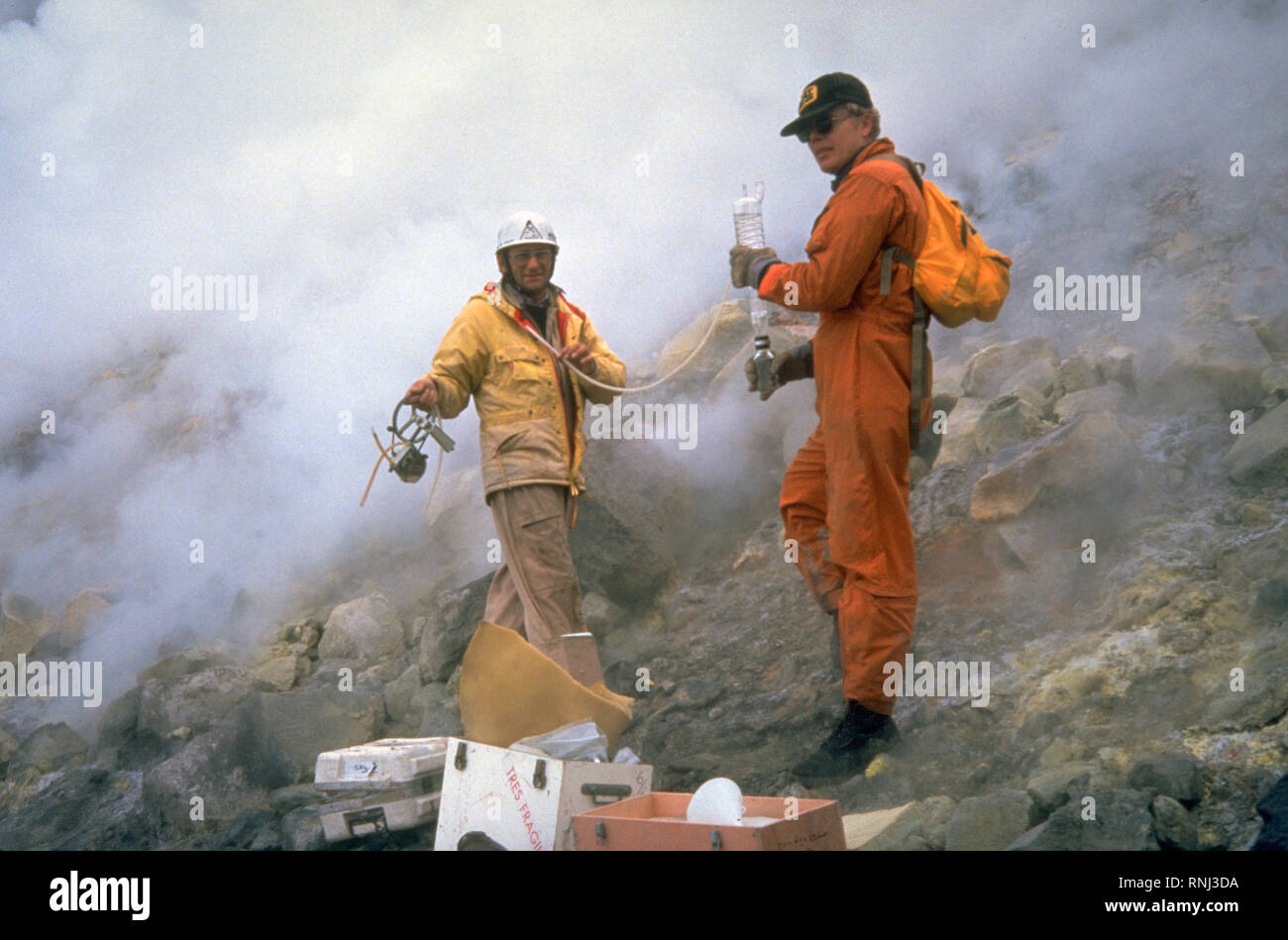 USGS geologists gathered samples by hand from vents on the dome and crater floor. Additionally, sulfur dioxide gas was measured from a specially equipped airplane before, during, and after eruptions to determine 'emission rates' for the volcano. 9/24/1981 - Stock Image