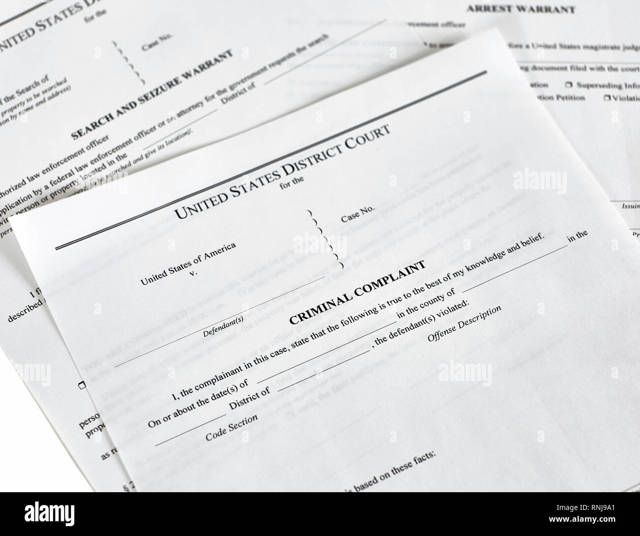 District Court criminal complaint, arrest warrant and search and seizure warrant doccuments isolated on white - Stock Image